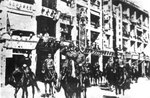 Takashi Sakai leading Japanese troops on a march on Queen