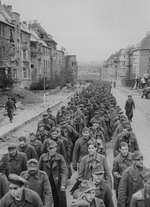 German prisoners marched through Aachen, Germany, circa late Oct 1944
