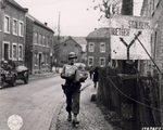 US Army Sergeant Joseph H. Kadlec delivering Christmas packages sent from home, Zweifall near Aachen, Germany, 14 Nov 1944