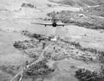 British Hawker Hurricane Mk IIC fighter of No. 42 Squadron RAF, piloted by Flying Officer Campbell, attacking a bridge on the Nambol River near Imphal, India, May 1944