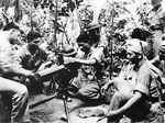 US Marines instructing Filipino aviation cadets on the use of a water-cooled .30 caliber Browning machine gun, circa 1941