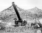 Men of 697th Field Artillery Battalion firing 240mm howitzer at Mignano, Italy, 30 Jan 1944
