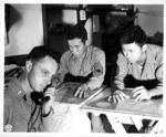 Japanese-American troops of the 522nd Field Artillery, US 442nd Regimental Combat Team working in the fire direction center, Castellina Sector, Italy, 12 Jul 1944