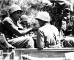 American soldier lighting cigarette of a Japanese-American soldier, both of the US Army, Castellina Sector, near Livorno, Italy, 25 Jul 1944