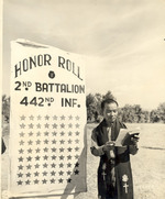 Japanese-American Chaplain Hiro Higuchi of 2nd Battalion, US 442nd Regimental Combat Team reading names of 72 fallen soldiers, Cecina area, Italy, 30 Jul 1944
