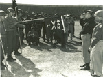 US Army Lieutenant General Lucian Truscott of 5th Army saluting guidon of Co. L, 3rd Btn, 442nd RCT, Livorno, Italy, 4 Sep 1945; note Presidential Unit Citation banner on guidon