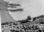 US Marine on Mount Suribachi, with landing craft in the background, Iwo Jima, Japan, 19-23 Feb 1945