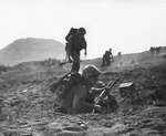 US Marine communicators dashed for cover, Iwo Jima, Japan, Feb 1945
