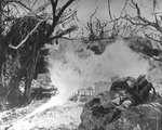 Two US Marines attacking with flamethrowers on Iwo Jima, Japan, 4 Mar 1945