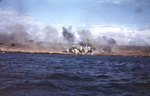 Explosions on an Iwo Jima beach, with smoke from other blasts drifting down wind, probably during the pre-landing bombardment, 19 Feb 1945