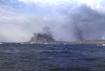 Dense smoke shrouded Mount Suribachi as LVTs left the beaches during the initial day of landings, Iwo Jima, 19 Feb 1945
