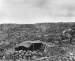 Sandbag, rock and canvas shelter in the rugged terrain of northern Iwo Jima, 21 Apr 1945