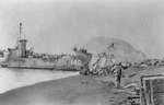 LSM-140 unloading on a southeastern Iwo Jima beach, circa 21-22 Feb 1945