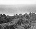 A Japanese patrol vessel wrecked on the rocky coast of northern Iwo Jima, 21 Apr 1945