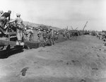 US Marines laying a pierced steel matting roadway on Red Beach, Iwo Jima, Japan, 25 Feb 1945