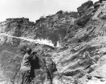 Flame thrower in use against Japanese holding out in a cave along Iwo Jima