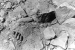 Hand of a buried Japanese soldier showing through the remains of a collapsed defensive position, Iwo Jima, Mar 1945