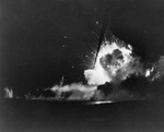 Carrier Bismarck Sea erupted in flames as she was hit by a special attack aircraft off Iwo Jima, night of 21 Feb 1945