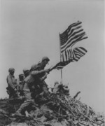 US Marines removing the first Mount Suribachi flag as the second flag was being raised, Iwo Jima, Japan, 23 Feb 1945