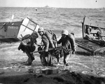 US Marine hauling an ammunition cart on Iwo Jima invasion beach, Japan, 19 Feb 1945