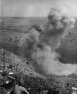 US Marine sealing the entrance of a Japanese tunnel on Mount Suribachi, Iwo Jima, Japan, 25 Feb 1945