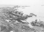 Wrecked LVT and other vehicles on the shores of Iwo Jima, Japan, 1945