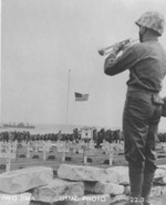 US Marine playing taps at the American cemetery on Iwo Jima, Japan, 1945