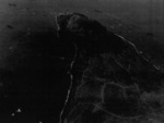 View of the northern face of Mount Suribachi, Iwo Jima, Japan, 7 Mar 1945; photo taken from an aircraft of USS Anzio