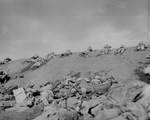 Men of USMC 5th Division advancing through the volcanic ash hills of Red Beach No. 1 at Iwo Jima, Japan, 19 Feb 1945, photo 1 of 2