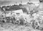 US Coast Guard and Navy personnel unloading supplies on the beaches of Iwo Jima, Japan, 19-20 Feb 1945