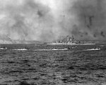 LVT landers carried US Marines past battleship Tennessee toward Iwo Jima, 19 Feb 1945