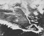 Aerial photograph of Iwo Jima during a raid on its southern Airfield Number One, early 1945, photo 1 of 2