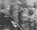 Aerial photograph of Iwo Jima during a raid on its southern Airfield Number One, early 1945, photo 2 of 2