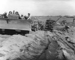 Bulldozer, Jeep, and other vehicles on an Iwo Jima beach, circa late Feb or early Mar 1945