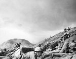 Men of USMC 5th Division advancing through the volcanic ash hills of Red Beach No. 1 at Iwo Jima, Japan, 19 Feb 1945, photo 2 of 2