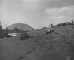 Iwo Jima landing beach, cluttered with abandoned vehicles and other debris, circa late Feb 1945