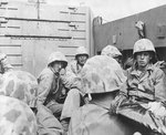 Marines crouched in a Coast Guard-manned LCVP on the way in on the first wave to hit the beach at Iwo Jima, 19 Feb 1945, photo 1 of 2