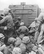 Marines crouched in a Coast Guard-manned LCVP on the way in on the first wave to hit the beach at Iwo Jima, 19 Feb 1945, photo 2 of 2