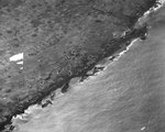 Aerial photo of wrecked American landing craft at Iwo Jima Beach, 21 Feb 1945