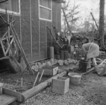 Mrs. T. Arima working in her garden at Jerome War Relocation Center, Arkansas, United States, 17 Nov 1942, photo 1 of 2