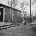 Mrs. T. Arima working in her garden at Jerome War Relocation Center, Arkansas, United States, 17 Nov 1942, photo 2 of 2