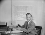 Project Director Paul Taylor of Jerome War Relocation Center at his office, Arkansas, United States, 18 Nov 1942, photo 1 of 2