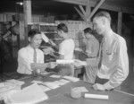 Postmaster Fred Paris with workers at the Jerome War Relocation Center post office, Arkansas, United States, 20 Nov 1942