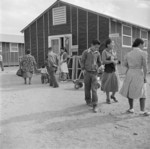 Japanese-American internees outside the canteen of Block 8 of Jerome War Relocation Center, Arkansas, United States, 17 Nov 1942
