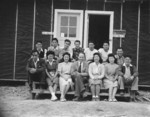 Charles Lynn (center) with his newspaper staff, Jerome War Relocation Center, Arkansas, United States, 16 Nov 1942