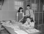 Postmaster Fred R. Paris with mail clerks, Jerome War Relocation Center, Arkansas, United States, 20 Nov 1942
