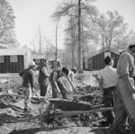 Men digging drainage ditches by the mess hall of Block 7 of Jerome War Relocation Center, Arkansas, United States, 16 Nov 1942, photo 2 of 2