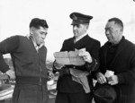 Royal Canadian Navy officer questioning Japanese-Canadian fishermen, 9 Dec 1941