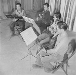 A string quartet practing, Jerome Relocation Center for Japanese-Americans, Jerome, Arkansas, United States, 12 Mar 1943; left to right: Yutaka Motasuda, Seichi One, John Yamashita, and Joe Iwasaki