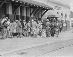 Japanese-Americans waiting for the train which would take them to a relocation center, California, United States, 5 Apr 1942